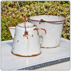 """Enamelware White Bucket  Shown on the right. 10"""" x 9"""" tall. Pictured with the Coffee Kettle Enamelware - White. Items rented separately."""