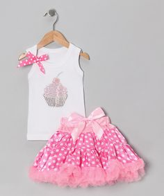 Designed especially for sweet girls who love treats, this party-perfect ensemble is packed with easygoing glamour. The tank shows off a sparkly cupcake design, while the frilly pettiskirt has a smooth, covered elastic waistband. Includes tank and pettiskirtPolyester / cottonMachine wash; tumble dry