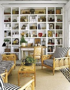 Love this room and black and white stripes with natural wicker. Great room, curtesy of Slim Paley.