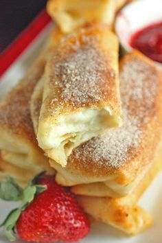 Fried Cheesecake Roll Ups with Strawberry Sauce. Add caramel sauce inside and they'll be like Del Taco's cheesecake bites. <3