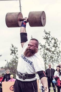 Strongman one arm dumbbell lift