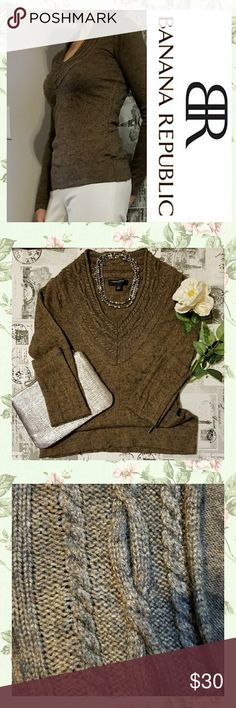 NEW LISTING!! Knit Top This knit top is smooth in it's styling with detail as shown around tge v-neck collar. The colors,are browns and black. The comfort cones from a blend of nylon 45%, viscose 29%, wool 23%, cashmere 3%. Size XS. Banana Republic Sweaters V-Necks