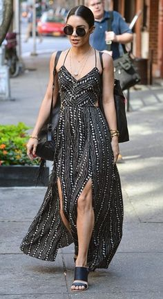 Vanessa Hudgens is seen leaving her apartment on June 9, 2015 in New York City, where she is currently appearing on Broadway as the lead in 'Gigi'. Vanessaá wearing an Ecote Strappy Back Safari Maxi Dress, The Row Round Sunglasses and a  Kenneth Cole bag. #vanessahudgens #style