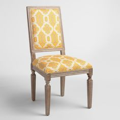 With warm amber-toned upholstery in an interlocking geometric design, our square-back dining chairs are subtle and sophisticated. An exposed oak wood frame with groove details and a distressed graywash finish adds to their timeworn appeal.