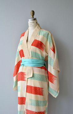 Antique 1920s cream silk kimono with bright red and cyan swaths, a nice shorter length and wide cyan sash.  ✂-----Measurements  fits like: free size bust: free waist: free length: 47 brand/maker: n/a condition: a stain at one shoulder, see close up photo  ✩ layaway is available for this item  to ensure a good fit, please read the sizing guide: http://www.etsy.com/shop/DearGolden/policy  ✩ visit the shop ✩ http://www.DearGoldenVintage.etsy.com