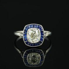 Magnificent Art Deco 2,10 cushion diamond and sapphires target platinum ring by hawkantiques on Etsy https://www.etsy.com/listing/449055128/magnificent-art-deco-210-cushion-diamond