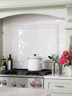 herringbone patterns: Subway tile backsplash with herringbone pattern be...