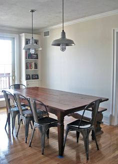 Industrial pendant lighting makes it's way into New England homes.
