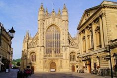 Historic square in Bath, England with the facade of Bath Abbey and the Roman Baths Stock Photo