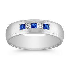 Princess Cut Sapphire and Diamond Ring. This vibrant and sophisticated men's ring is crafted in quality 14 karat white gold with a satin finish. Three princess cut sapphires, at approximately .24 carat TW, and two princess cut diamonds, at approximately .16 carat TW, provide color and sparkle. The total gem weight is approximately .40 carat. #ShaneCoLBD