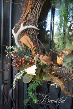 Must See Fall Front Porch Decorating Ideas. Must See Fall Front Porch Decorating Ideas.Like the Deer Antler. Autumn Wreaths, Christmas Wreaths, Christmas Decorations, Wreath Fall, Christmas Colors, Christmas Ideas, Antler Wreath, Pumpkin Topiary, Pumpkin Lights