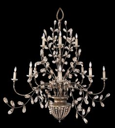 Chandelier in a cool moonlit patina with moon dusted tendrils and pendant drops.