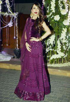 Malaika Arora Khan looked ravishing in a purple Manish Malhotra outfit at Manish's niece Riddhi's sangeet.