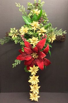 Holiday 2014 Season Faux Memorial Cross: red poinsettia and mini gold glitter poinsettias on Grapevine cross. Original design and arrangement by http://nfmdesign.synthasite.com/