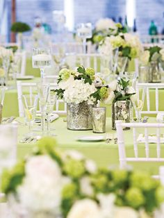 I am very into green and white for decorating this spring!  I love the flowers in mercury glass, it really pops out on the table yet it is still elegant.  Via Hostess with the Mostess