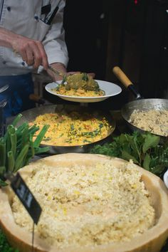 Cook picks up risotto - download this beautiful picture in hi-res for FREE from foodiesfeed.com / #free #download #hires #foodphotography #food #picture #photography #design #nocopyright