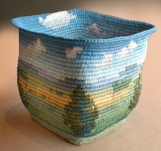 Tapestry crochet art by Caroline Routh. A crocheted bowl with a landscape. Looks like drawn :)