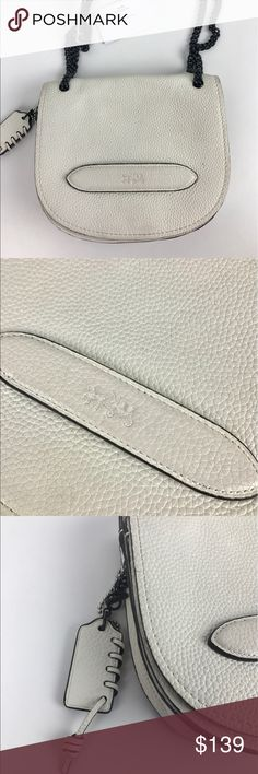 """Coach Shadow Crossbody in White Leather Authentic. Gently used. Good condition inside and out with some signs of wear. See photos.   With a tough curb-chain strap on a timeless saddle bag shape, this petite bag updates an iconic Coach silhouette with a fresh spirit of rebellion. Strap with 8 3/4"""" drop for shoulder or crossbody wear. 7"""" (L) x 6"""" (H) x 2 1/4"""" (W)  Thank you for your interest!  PLEASE - NO TRADES / NO LOW BALL OFFERS / NO OFFERS IN COMMENTS - USE THE OFFER LINK :-) Coach Bags…"""