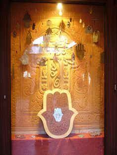 In Arabic and Berber culture, the khamsa, an amulet that is worn as jewelry or displayed in homes, is believed to ward off the evil eye. Protection Symbols, Islamic World, Protecting Your Home, Hand Of Fatima, Evil Spirits, Evil Eye, Egyptian, Roots, Objects