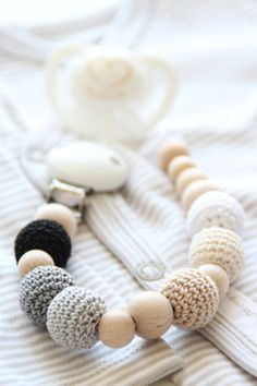 Neutral baby pacifier clip / Teething by ZanesCrochetTreasure