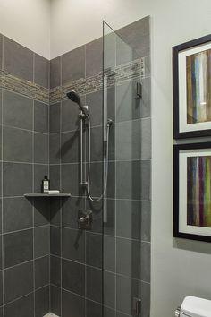 Slate tiles and a frameless shower door create a nice corner shower in this Austin, Texas pool bath. Dawn Hearn Interior Design www.dawnhearn.com