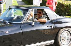 Bruce Springsteen and Patti Scialfa drive a Corvette.