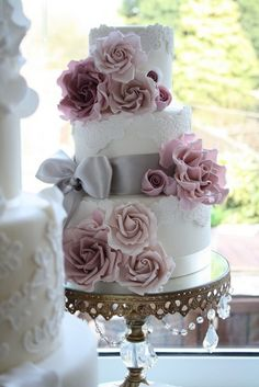 3-tier white lace fondant wedding cake with huge edible sugar pink roses. Vintage Wedding cake with cake stand