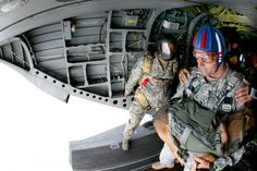 U.S. Army 1st Sgt. Chris Lalonde, center, holds his military working dog, Sgt. Maj. Fosco on the ramp of a CH-47 Chinook helicopter before their historic tandem airborne jump from an altitude of 12,500 feet on Fort Leonard Wood, Mo. Sept. 18, 2009. Lalonde is assigned to Company D, 701st Military Police Battalion. U.S. Army photo by Sgt. Vince Vander Maarel
