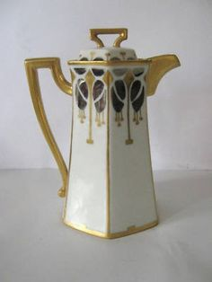 This small pot is just over inches to the top of the lid. It is hand decorated in gold and silver in an art deco manner. I'm not sure of it's use, but it may be an individual serving pot for hot Teapots And Cups, Teacups, Art Nouveau, Tea And Crumpets, Tea Party Table, Tea Art, Art Deco Era, Chocolate Pots, Antique China