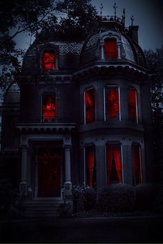 This has to be a house for Halloween.   Red in the windows makes it very creepy.