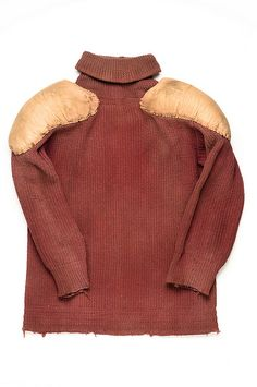 Man's football uniform, c. 1910    The maroon rib-knit wool sweater, padded gold canvas pants and brown leather helmet were probably worn by Robert Lane McCrady (1888-1945) at the College of Charleston. The pants have a front fly with metal grommets for lacing. Pads are sewn inside front and back hips and front at knees. Thigh fronts have inserted vertical rods, probably wood. The helmet is lined with cotton batting.  Gift of the Estate of Emily S. McCrady (Robert's sister) in 1975