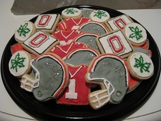 Ohio State Buckeyes- need to do these for Kel. It would be better if it was Texas Longhorns cookies though. Ohio State Buckeyes, Ohio State Football, Ohio State University, Football Football, Cut Out Cookies, Cupcake Cookies, Sugar Cookies, Cupcakes, Buckeye Cookies