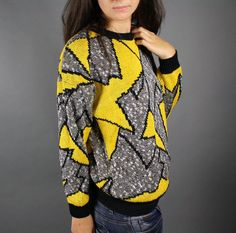 Amazing 80s Cosby sweater with a yellow, black, gray and white design. Super comfy, not at all scratchy. $28