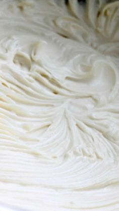 The BEST Cream Cheese Frosting ~ This frosting is stiff, sturdy, pipe-able, spreadable and it's not overly sweet. The big difference between this recipe and all those other ones, is that this recipe uses more butter and less powdered sugar.