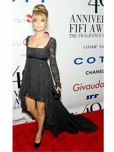 We thought #NicoleRichie stunned the crowd in a lacy black high-low, long-sleeve gown. #BestFashionMoments