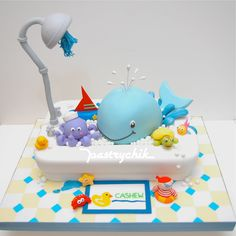 cute baby cake with whale and octopus in a bath tub