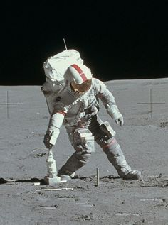 Apollo 15 astronaut Dave Scott picks up a drill off the surface of the Moon, August 1, 1971.