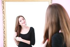 woman smiling mirror africa studio/shutter