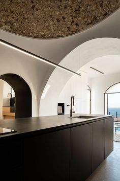 pitsou kedem architects has refurbished a historic apartment in jaffa, the ancient port city located south of tel aviv's urban center in israel.