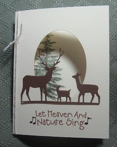 By Doris. Die-cut deer and die-cut oval in card front. Tree stamped on inside right panel of card so that it show through the oval opening.