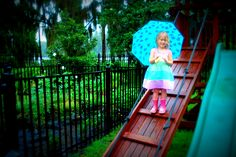 don't stay inside if it's raining - take the kids out for a pretend Photo Shoot!... the rain from tropical storm debby might be a pain, but the colors outside are AMAZING... this picture is unedited in original form... garden is growing strong... or flooding... one of the two?! lol