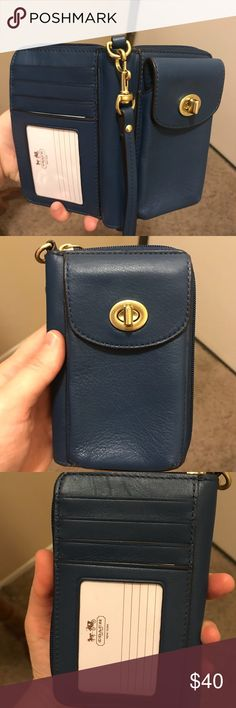EUC authentic Coach wristlet Deep blue color with gold accents. Coach insert card included. Wallet interior which zips closed and cell phone/money holder on the front. Note: does not fit iPhone 6 or 7. Let me know if you need exact dims Coach Bags Clutches & Wristlets