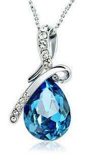 An elegant Arco Iris Brand ocean blue teardrop Swarovski elements crystal dangles from stylized strands of sparking clear rhinestone crystals on  ...