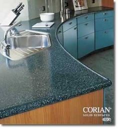 """The photo shows a Corian countertop with a """"Marine Edge."""" These raised edge counters got their name from being used on boats. They're also called """"Spill-proof"""" edges. Perfect for an RV counter that may not be perfectly level when you park. Blue Kitchen Countertops, Corian Countertops, Kitchen Worktops, Key Kitchen, Kitchen Decor, Kitchen Ideas, Built In Cabinets, Building A New Home, Undermount Sink"""