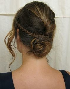 Make the tiny braid first and then roll the other half of the hair as if making a pleat. Gather the rest of the hair and secure into a bun