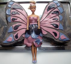 Barbie with butterfly wings cake
