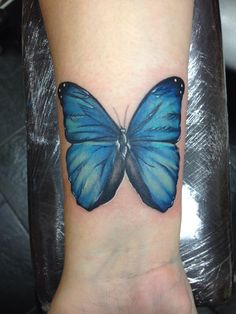 Gorgeous Sky Blue Butterfly Tattoo