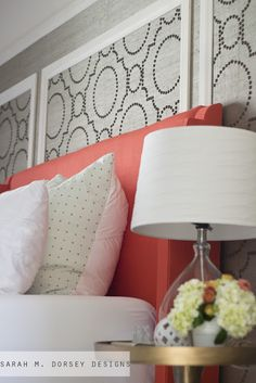 DIY Coral Upholstered Headboard with Curved Arms - love the wall paper framed behind the upholstered headboard.  And I love the color pop!