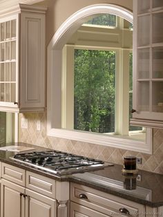 #Kitchen Idea of the Day: Antique White Kitchen Cabinet. Beautiful pass-through window with an arch.