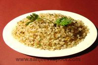 Sabudana Khichdi - A dish speically made during fasts - sago cooked with potatoes and crushed peanuts.